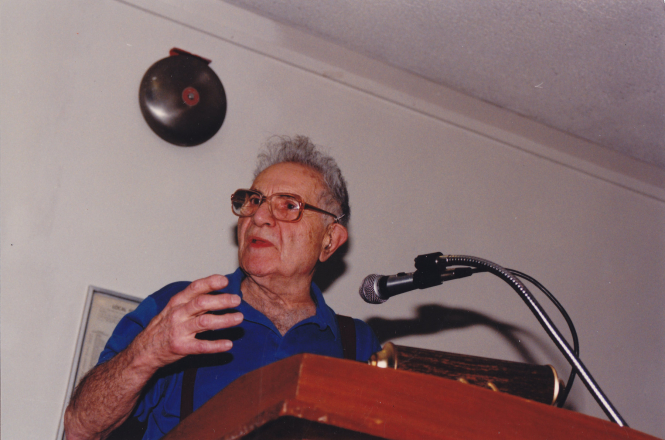 Photograph of Herman Benson delivering a speech at a lectern