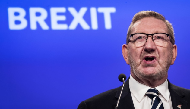 "Len McCluskey in front of a background which says ""Brexit"""