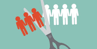 "Cartoon graphic of a pair of scissors clipping a paper people chain, half of which is red, and half of which is white, indicating ""job cuts"""