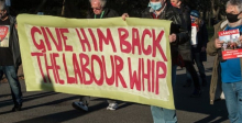 """Give him back the Labour whip"" banner"