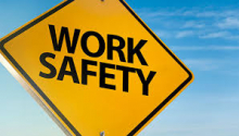 "A yellow sign reading ""Work Safety"""