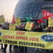"A crowd of RMT members with a banner reading ""Stop ticket office cuts, London Underground"""